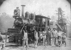 Mason Lumber Company's crew and Climax locomotive at Gandsi, Mississippi. Gandsi was a name coined from the initials of the Gulf & Ship Island (G) Railroad. It was located north of present-day Seminary, Mississippi. The Climax was the least popular of the three major types of geared locomotives used by Mississippi loggers. Geared locomotives were slow but highly flexible on the rough track of temporary logging spurs.