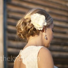 After the ceremony, Laura took off her veil and tucked a white flower into her loose up do.