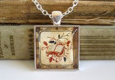 Book Necklace - Antique Print Pendant W/ Chain in Silver  Eternally sealed under glass, this beautiful book print is set in a 1inch by 1