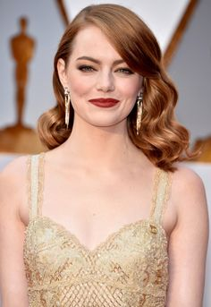 EMMA STONE -    While the Best Actress nominee's bold red lipstick (in the shade Mona from NARS) was the focal point of her look, which makeup artist Rachel Goodwin says was inspired by the romantic paintings by Dante Gabriel Rossetti, we couldn't help but be captivated by Stone's bronze-hued eyes, too.
