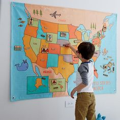 Before you drive across the country with your friends for some spontaneous site-seeing, maybe you should think about picking up this big, soft wall map instead.  It features a colorful and interactive United States map, as well as removable landmarks, capitals and state names.  And, best of all, nobody gets car sick.