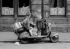 Glasgow - in the old Gorbals - 1961. Kids play on a motorbike.