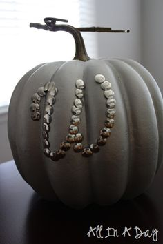 Painted pumpkin with thumbtack monogram