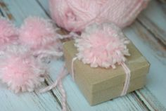"""Easy Pom Pom Gift Bow Tutorial: Gift """"trimmings"""" like wrapping paper, tissue paper, boxes, fancy ribbons and bows, etc. can all add up fast. Make your own gift bows to save money and add a personal touch to any gift."""