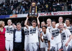 The Connecticut Huskies celebrate with the trophy after their 82-51 victory over the Syracuse Orange to win the championship game of the 2016 NCAA Women's Final Four Basketball Championship at Bankers Life Fieldhouse on April 5, 2016 in Indianapolis, Indiana.