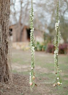 some great woodland wedding ideas on this site! love this swing. so pretty.
