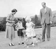 Royal Family play with their corgis. Queen Elizabeth and the Duke of Edinburgh with their children  Prince Charles  and Princess Anne play with the Queen's #Corgi dog Sugar and the Dukes dog Candy at Balmoral 14th September 1955