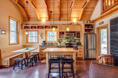 Rustic Kitchen with Exposed beam, double-hung window, Undermount sink, Kichler wedgeport bronze finish pendant chandelier