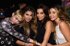 Pin for Later: Miley Cyrus Makes Out With Patrick — and Paris?! — in Miami  Miley hung out with a group of ladies, including Eva Longoria and Larsa Pippen.