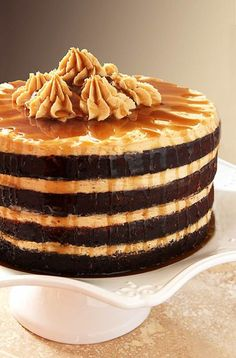 Rich dark chocolate cake layered with fluffy peanut butter buttercream and a brown sugar and rum drizzle — we're celebrating big time with this Espresso Chocolate Cake with Peanut Butter Frosting and a Rum Drizzle.
