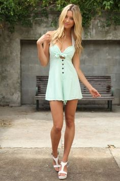 Shop this look on Lookastic:  https://lookastic.com/women/looks/mint-playsuit-white-leather-wedge-sandals/12402  — Mint Playsuit  — White Leather Wedge Sandals