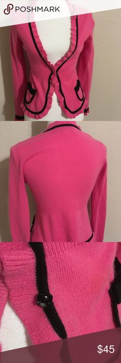 Nanette Lepore pink cardigan with bow pockets sm Cute cute cashmere sweater with ruffles and the cutest bow pockets. No piling non smoking home. Buttons in front are little flowers. Measures 24 inches long. 100% cashmere Nanette Lepore Sweaters Cardigans