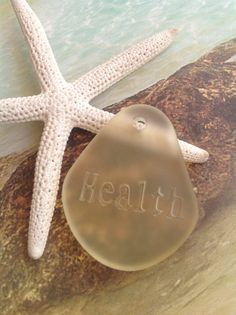 New health word beads~sea glass quote pendants~cultured sea glass beads.  Soft lemon yellow.  We carry many colors in this beautiful new bead~pendant.  Cultured sea glass ~ engraved health inspirational beads. These cultured sea glass,beach glass beads are made from high quality recycled glass and are tumbled in diamond sand (1 to 2 weeks )to look like they were just picked from the ocean and sand.  Perfect for a focal bead, charm, dangle or your jewelry designs. Eco friendly Nugget styled…