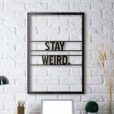 """Stay Weird // Framed (19.7""""W x 27.5""""H x 0.5""""D)"""