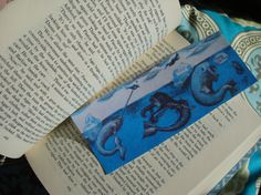 blue mermaid, narwhal, walrus drawing on a book mark