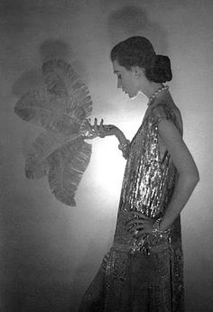 Dovima in a dress by Chanel, photographed by Cecil Beaton, 1953.