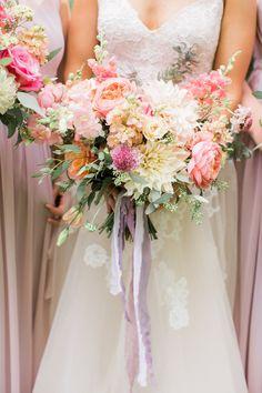Pretty pink dahlia bridal bouquet with lavender silk ribbon.