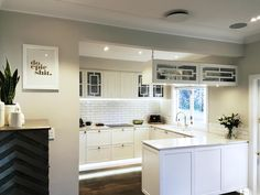 Beautiful white kitchen with a mix of contemporary and traditional feel. Custom designed and made cabinetry with brass detail. New Zealand made kitchen Custom Design, Kitchens, Kitchen Cabinets, Brass, Traditional, Contemporary, Detail, Beautiful, Home Decor