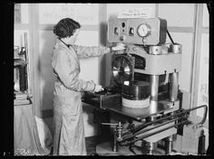 A photograph of a woman pressing records on a Filmophone machine, taken in March 1932 by Leslie Cardew for the Daily Herald.        Early records were made of shellac, a brittle resin easily broken or scratched. In response, Filmophone developed a flexible transparent celluloid record which they produced in England during 1931-1932.