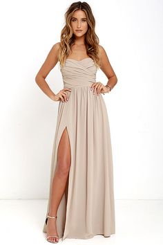You'll be admired as soon as you set foot in the party wearing the Moonlight Serenade Taupe Strapless Maxi Dress! Draping woven poly fabric adorns a strapless sweetheart neckline with lightly padded cups and no-slip strip. A gathered waist introduces a full, maxi skirt with sexy side slit. Hidden back zipper and clasp.