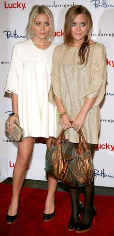 Twinning combo: The statement-making duo swapped their polished separates for cozy swing dresses at an LA trunk show. Ashley chose a pristine white number with contrasting black pumps and an embellished box clutch. Mary-Kate worked a pearlized linen dress with opaque black tights and matching pumps while toting an iridescent satchel.
