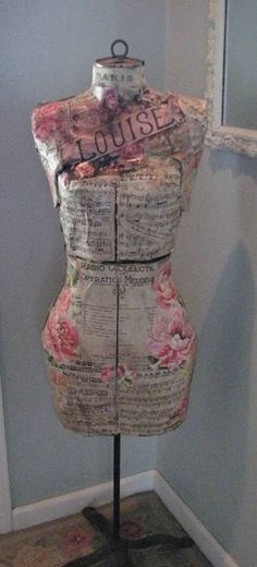 Love this decoupage mannequin.    We sell gently used mannequin dress forms for projects like this at MannequinMadness.com