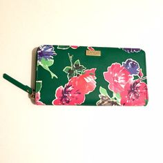 "listing! Kate Spade Neda Wallet Spring Bloom Spring has finally sprung! Gorgeous NWT Kate Spade Neda wallet. Gold zipper closure. 12 card slots, zip coin pocket. Approximately 7.5""L 4""H  This item qualifies for free shipping- just ask! kate spade Bags Wallets"