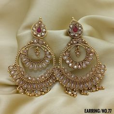 Golden and Red Stone Studded. Rama Creations Manufacturer & Wholesalers of Imitation Bridal Jewellery in India. Indian Jewelry Earrings, Indian Jewelry Sets, Jewelry Design Earrings, Indian Wedding Jewelry, Gold Earrings Designs, Designer Earrings, Jewelry Accessories, Antique Jewellery Designs, Fancy Jewellery