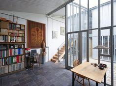 """Located on a quiet side street just off Deptford High Street, this award-winning two-bedroom courtyard house has been described by RIBA judges as """"an exemplary response to its urban setting"""". It was sold by The Modern House in 2014. Constructed between 2003 and 2005, the house constitutes one half of a building designed by DSDHA […]"""