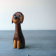 A whimsical dog figurine by Danish Designer Laurids Lonborg. Best known for his cat figurines and Kinetic Ball Sculptures. This is the rare,