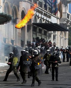 molotov cocktails flies above the heads of riot police