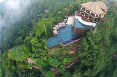 Twin level cascading infinity pools suspended above a tropical rainforest are just the beginning at ... - Hanging Gardens Ubud