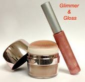 """Hey Cha""  ---- Glimmer and Gloss  Includes: Touch of the Tropic Face and Body Bronzer powder and First Kiss lip gloss.    Vie Perk Price $15.00  Retail Value $30.50"