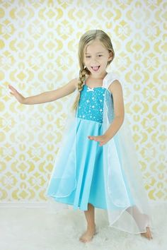 PRACTICAL PRINCESS ELSA DRESS This is a fun new PRACTICAL PRINCESS dress for your little girl. This dress has a sweetheart neckline, with , cute gathered strap sleeves and circle skirt. The back has elastic and a waist tie for a fit that is comfortable to wear as well as cute. The