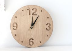Wall clock made out of solid oak, convex round shape minimalistic style. €90,00, via Etsy.