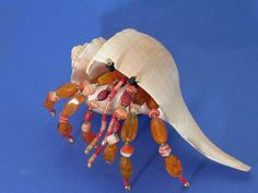 OOAK Beaded Lightning whelks Hermit Crab Decoration / Figurine      Up for sale is a great Beaded Hermit Crab Decoration / figurine that was