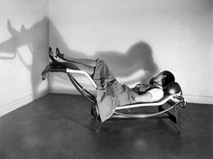 Charlotte Perriand in the LC4, demonstrating its different sitting Positions.