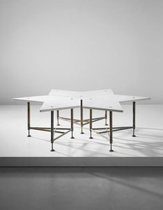 GIO PONTI Rare set of three modular coffee tables, circa 1948 Marble, tubular brass, brass. Each: 40 x 63 x 73 cm (15 3/4 x 24 3/4 x 28 3/4 in.) Executed by Giordano Chiesa, Milan, Italy. Together with a certificate of authenticity from the Gio Ponti Archives.