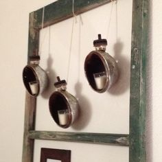 Old off road light housings made into wall candle decorations
