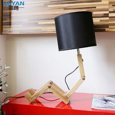 94.94$  Watch now - http://ali4hu.worldwells.pw/go.php?t=32596668838 - Modern Home Decoration Small Wood Person Table Lamp Bed Llight Folding Child Lamp Study Light  Free Shipping