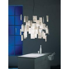 #Zattel'z 5 is a suspension #lamp with a unique #design by #IngoMaurer. The central body is surrounded by sheets on which you can write down your ideas