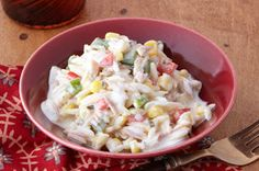Vegetable orzo pasta with cream cheese. We add ground beef to it too.