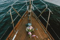 White and Purple Flowers Bouquet on Brown Wooden Boat Ground on Body of Water · Free Stock Photo Purple Flower Bouquet, Purple Flowers, Wedding Looks, Dream Wedding, Wedding Day, Got Married, Getting Married, White Magic Spells, Bride Tiara