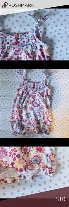 Koala Baby flowered summer romper size-9 mos. I'm in love with this little summer outfit! All the fun colors, flowers and details make it an adorable staple! It snaps at the bottom and has little bows on the straps. Three multicolored buttons decorate the little pleats on front. I felt it ran a little big and we were able to wear it into 16 mos. and she's very tall. I loved putting an extra onesie underneath for more color. Little wear and cared for. Let me know if you have questions! Koala…