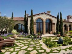 Italian Patio Landscaping: Arched entries and a water feature make this patio a Tuscan-style living area. From HGTVRemodels.com