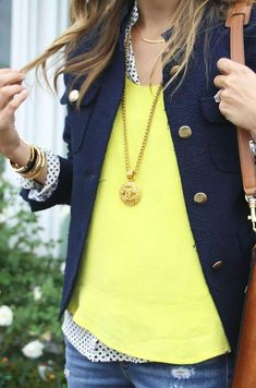 Navy blazer yellow sweater, white with navy polka dots gold jewelry, pendant necklace with long chain