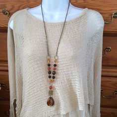 """Earth Tone Bead Necklace 34"""" in length with a 4"""" drop at the end.  Earth tone Colors.  Feel like glass beads. Used but cute. Jewelry Necklaces"""