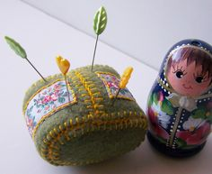 Not super crazy about the shape of this pincushion, but the colors are cute and I like how the fabric is embroidered onto the felt.
