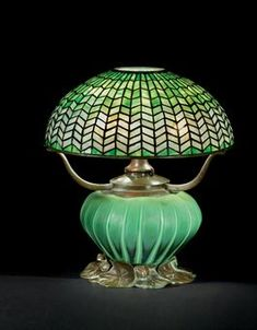 Leaded Glass and Bronze Table Lamp with blown glass base, circa 1905,  