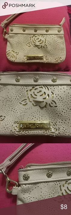 "Betsey Johnson White & Gold Rose Wristlet Metallic gold and white (creamish color)  Wristlet strap can be clipped on or off  5 gold roses on front at top  Zipper closure  Fun ""Betsey Johnson"" lining  Gold rose detail on front and back  BUNDLE & SAVE 💕 10% off 2 items or more!! Shop my closet to save on shipping!!! Betsey Johnson Bags Clutches & Wristlets"